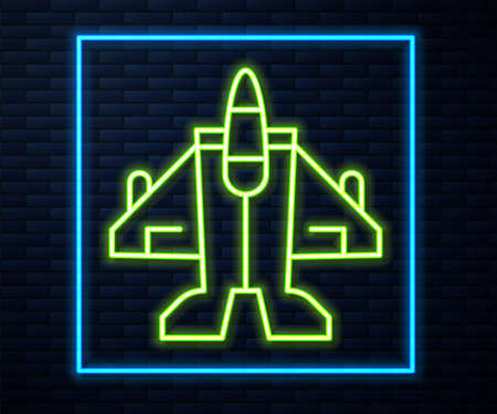 Glowing neon line Jet fighter icon isolated on brick wall background. Military aircraft. Vector Ilustrace