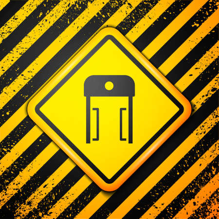 Black Metal detector in airport icon isolated on yellow background. Airport security guard on metal detector check point. Warning sign. Vector