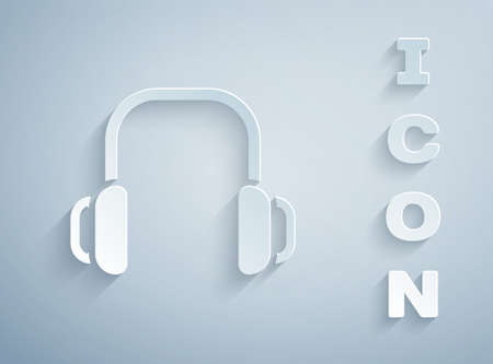 Paper cut Winter headphones icon isolated on grey background. Earmuffs sign. Paper art style. Vector 向量圖像