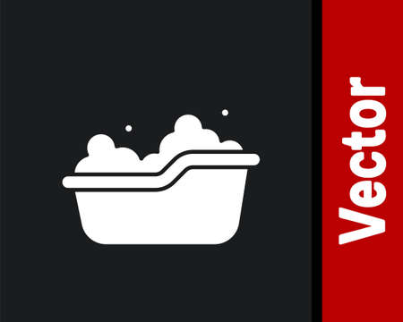White Baby bathtub with foam bubbles inside icon isolated on black background. Vector