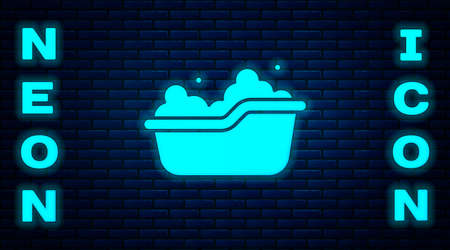 Glowing neon Baby bathtub with foam bubbles inside icon isolated on brick wall background. Vector Иллюстрация
