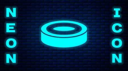Glowing neon Checker game chips icon isolated on brick wall background. Vector