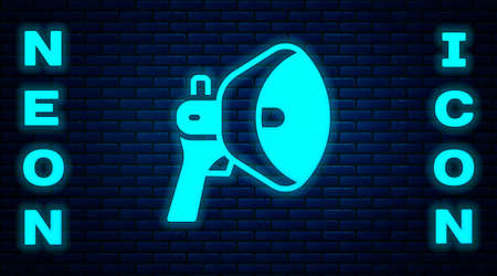 Glowing neon Megaphone icon isolated on brick wall background. Speaker sign. Vector Çizim