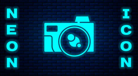 Glowing neon Photo camera icon isolated on brick wall background. Foto camera icon. Vector