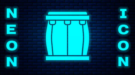 Glowing neon Drum icon isolated on brick wall background. Music sign. Musical instrument symbol. Vector