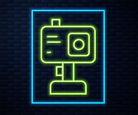 Glowing neon line Action extreme camera icon isolated on brick wall background. Video camera equipment for filming extreme sports. Vector