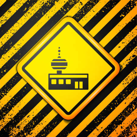 Black Airport control tower icon isolated on yellow background. Warning sign. Vector