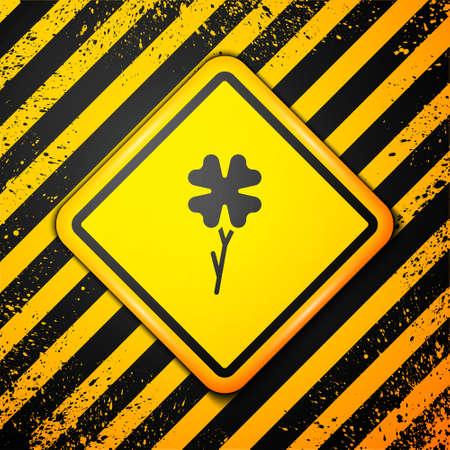 Black Four leaf clover icon isolated on yellow background. Happy Saint Patrick day. Warning sign. Vector