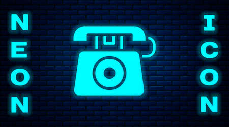 Glowing neon Telephone with emergency call 911 icon isolated on brick wall background. Police, ambulance, fire department, call, phone. Vector