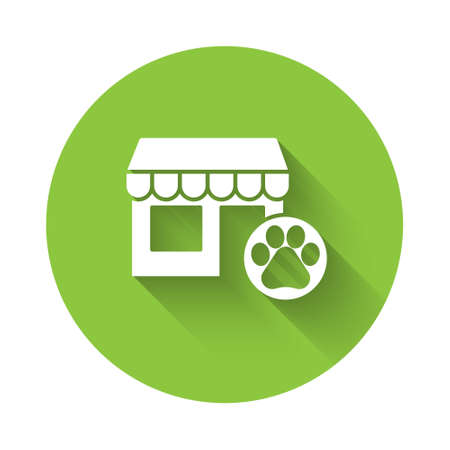 White Veterinary medicine hospital, clinic or pet shop for animals icon isolated with long shadow. Vet or veterinarian clinic. Green circle button. Vector  イラスト・ベクター素材