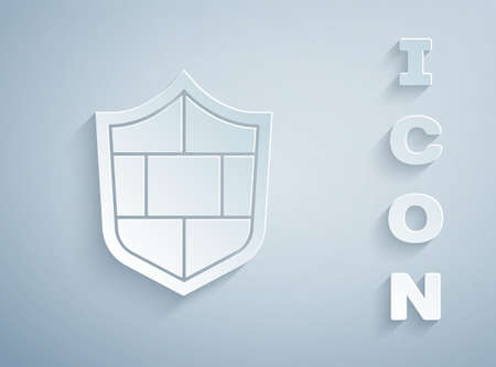 Paper cut Shield with cyber security brick wall icon isolated on grey background. Data protection symbol. Firewall. Network protection. Paper art style. Vector Vettoriali