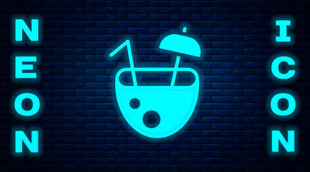 Glowing neon Coconut juice exotic fresh cocktail and umbrella icon isolated on brick wall background. Vector
