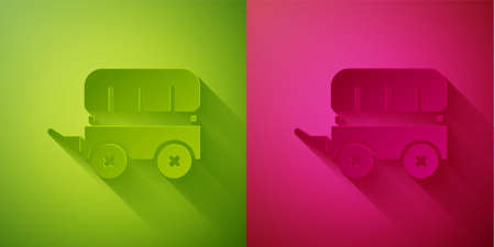 Paper cut Wild west covered wagon icon isolated on green and pink background. Paper art style. Vector