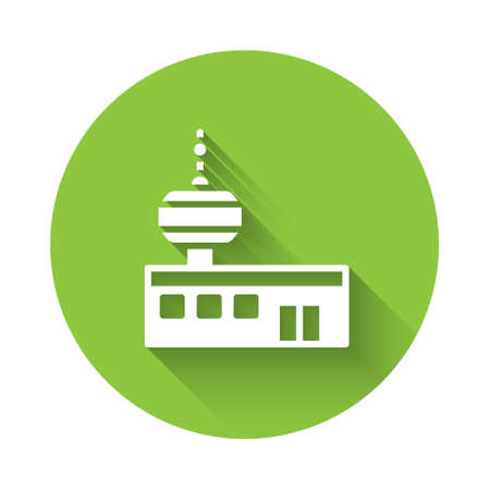 White Airport control tower icon isolated with long shadow. Green circle button. Vector