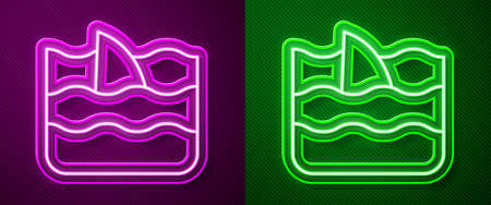 Glowing neon line Shark fin in ocean wave icon isolated on purple and green background. Vector