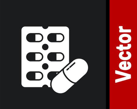 White Pills in blister pack icon isolated on black background. Medical drug package for tablet, vitamin, antibiotic, aspirin. Vector Illustration