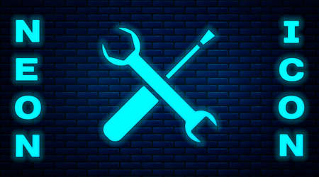 Glowing neon Screwdriver and wrench spanner tools icon isolated on brick wall background. Service tool symbol. Vector Illustration  イラスト・ベクター素材