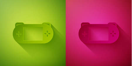 Paper cut Portable video game console icon isolated on green and pink background. Gamepad sign. Gaming concept. Paper art style. Vector