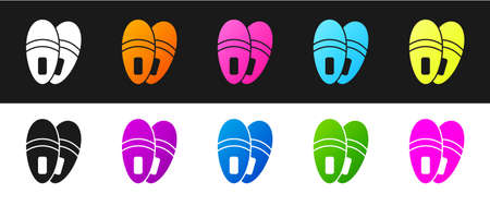 Set Slippers icon isolated on black and white background. Flip flops sign. Vector