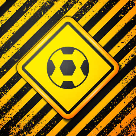 Black Football ball icon isolated on yellow background. Soccer ball. Sport equipment. Warning sign. Vector