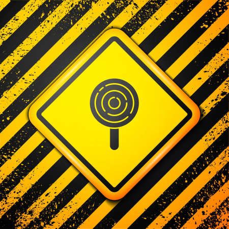 Black Lollipop icon isolated on yellow background. Candy sign. Food, delicious symbol. Warning sign. Vector