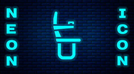 Glowing neon Airplane seat icon isolated on brick wall background. Vector
