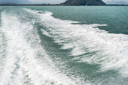 Bubble waves from boats in the sea Imagens