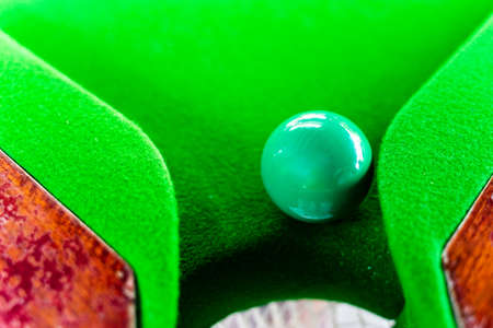 Green snooker balls on the snooker table Imagens