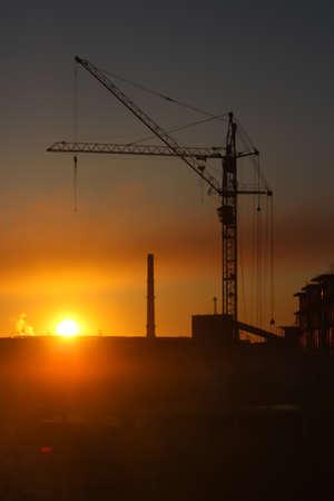 Fiery sunrise over an industrial area