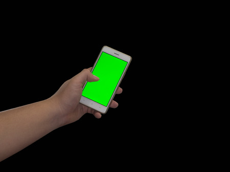 landscape mode: Man holds in hands tablet PC in landscape mode with green screen isolated on black. Chroma key screen for placement of your own content.