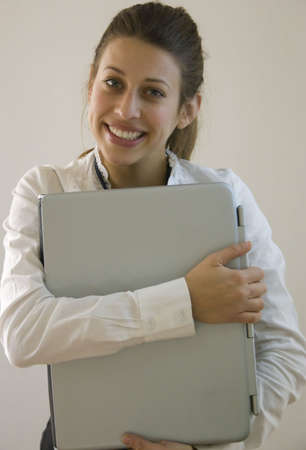 woman holding laptop Stock Photo - 4298435