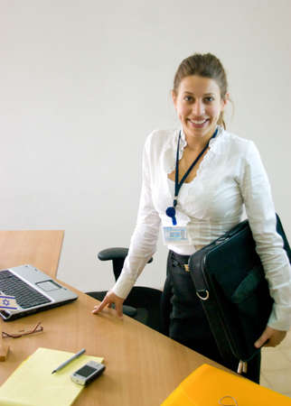 Business woman holding laptop case and getting ready to startend her working day