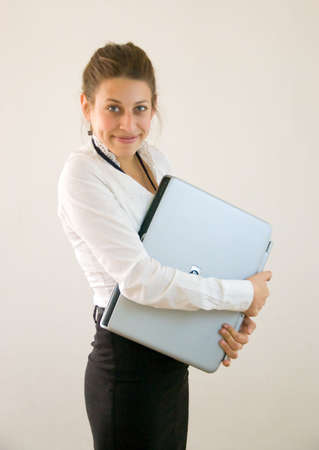 Business woman holding laptop at office looking into the lens Stock Photo - 4365566