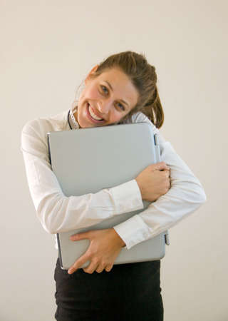 Business woman holding laptop at office looking into the lens Stock Photo - 4363098