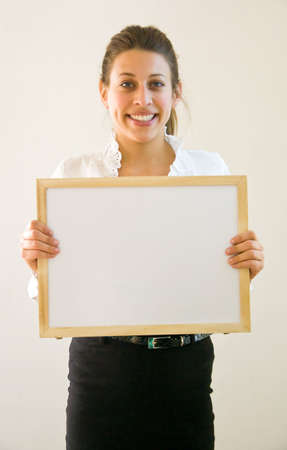 Business woman holding blanco sign at office looking into the lens Stock Photo - 4365567