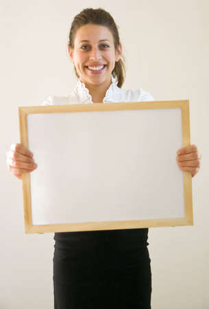 Business woman holding blanco sign at office looking into the lens Stock Photo - 4365563