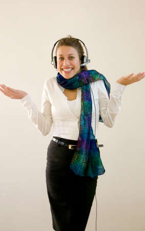 woman with headset could be support person or secretary in a online meeting.