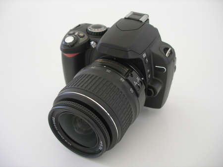 digital camera with lens on white background. View from the top. Stock Photo