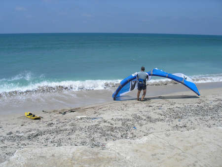 kite surfer on the beach in Israel getting ready to go in the water