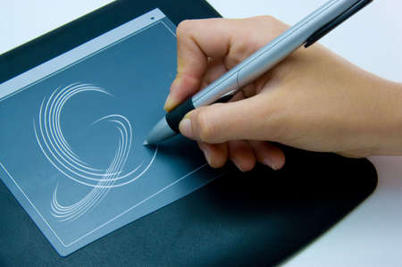 designer is using a digital drawing pad for her computer
