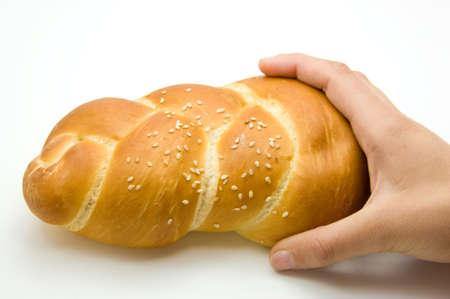 shabbat: Shabbat bread held by a female hand on a white background Stock Photo