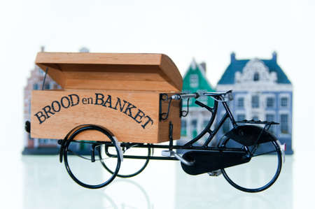 Bakery bicycle breadcar against old Dutch houses. Stock Photo