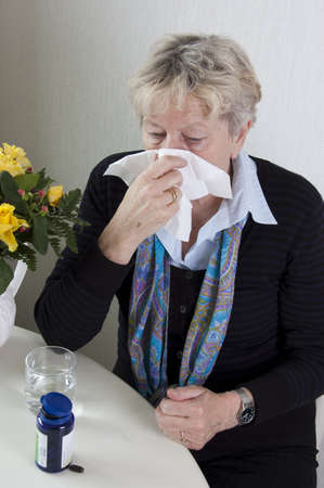 Older woman has the flue. Seniors and health