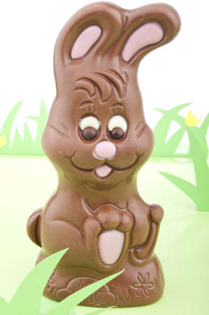 Easter bunny made out chocolate in a field of grass. Stock Photo