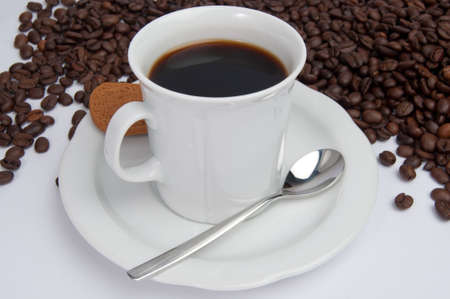 Coffee mug on a white background surrounded by coffee beans Stock Photo