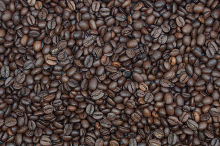 Background of cooffeebeans spread all over the image photo