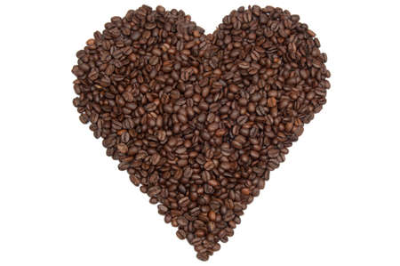 Heart shape of coffee beans against a white background