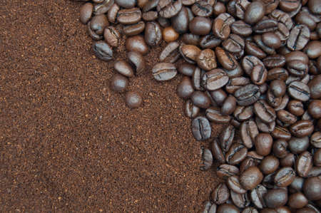 Closeup of coffee grind and beans in the background