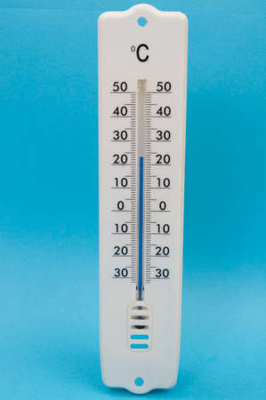 Thermometer against blue background with blue mercury photo