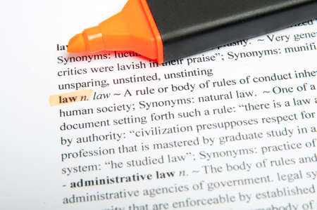Translation of the word law in the dictionary with highlight marker photo